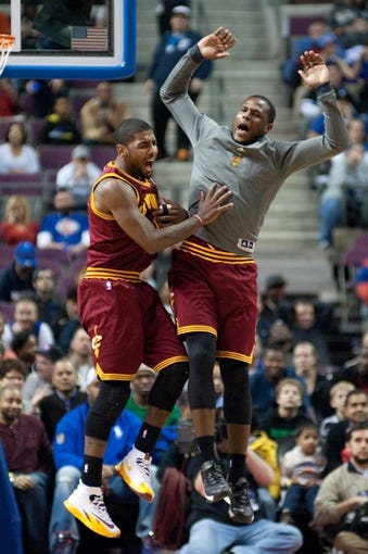 Feb 12, 2014; Auburn Hills, MI, USA; Cleveland Cavaliers point guard Kyrie Irving (2) celebrates after making a three pointer during the fourth quarter against the Detroit Pistons at The Palace of Auburn Hills. Cleveland won 93-89. Mandatory Credit: Tim Fuller-USA TODAY Sports