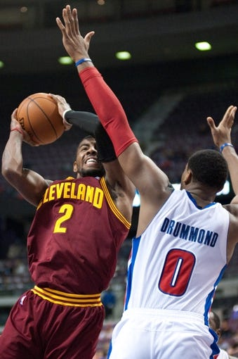 Feb 12, 2014; Auburn Hills, MI, USA; Cleveland Cavaliers point guard Kyrie Irving (2) goes to the basket against Detroit Pistons center Andre Drummond (0) during the fourth quarter at The Palace of Auburn Hills. Cleveland won 93-89. Mandatory Credit: Tim Fuller-USA TODAY Sports