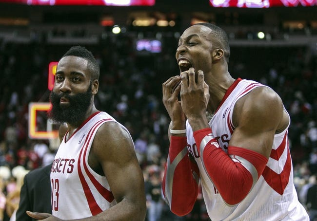 Feb 12, 2014; Houston, TX, USA; Houston Rockets shooting guard James Harden (13) and center Dwight Howard (12) react after defeating the Washington Wizards 113-112 at Toyota Center. Mandatory Credit: Troy Taormina-USA TODAY Sports