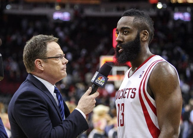 Feb 12, 2014; Houston, TX, USA; Houston Rockets shooting guard James Harden (13) is interviewed after a game against the Washington Wizards at Toyota Center. The Rockets defeated the Wizards 113-112. Mandatory Credit: Troy Taormina-USA TODAY Sports