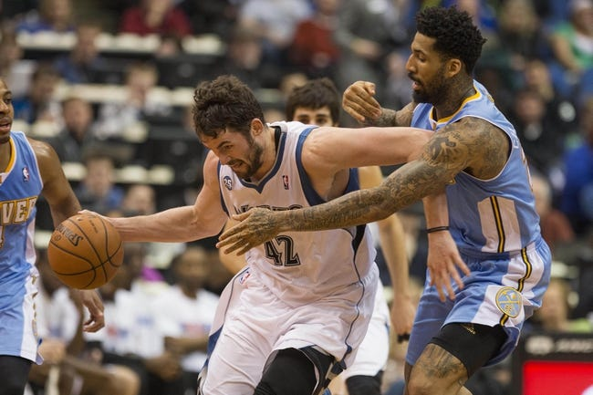 Feb 12, 2014; Minneapolis, MN, USA; Minnesota Timberwolves power forward Kevin Love (42) gets fouled by Denver Nuggets small forward Wilson Chandler (21) in the second half at Target Center. The Timberwolves won 117-90. Mandatory Credit: Jesse Johnson-USA TODAY Sports