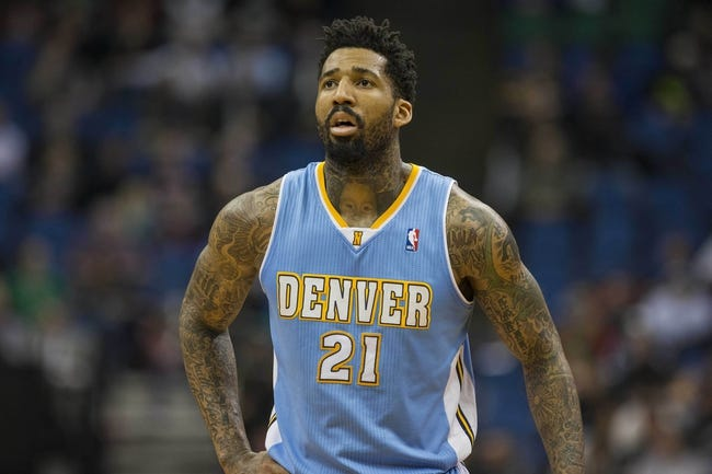 Feb 12, 2014; Minneapolis, MN, USA; Denver Nuggets small forward Wilson Chandler (21) looks on during the second half against the Minnesota Timberwolves at Target Center. The Timberwolves won 117-90. Mandatory Credit: Jesse Johnson-USA TODAY Sports