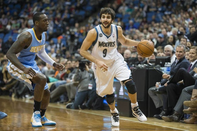 Feb 12, 2014; Minneapolis, MN, USA; Minnesota Timberwolves point guard Ricky Rubio (9) drives to the basket against the Denver Nuggets in the second half at Target Center. The Timberwolves won 117-90. Mandatory Credit: Jesse Johnson-USA TODAY Sports