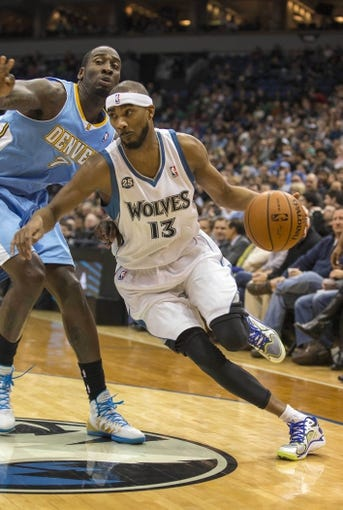 Feb 12, 2014; Minneapolis, MN, USA; Minnesota Timberwolves small forward Corey Brewer (13) drives to the basket past Denver Nuggets center J.J. Hickson (7) in the second half at Target Center. The Timberwolves won 117-90. Mandatory Credit: Jesse Johnson-USA TODAY Sports