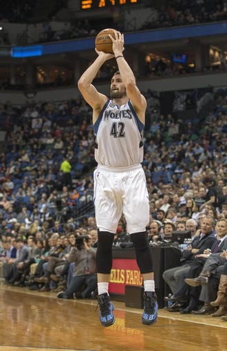 Feb 12, 2014; Minneapolis, MN, USA; Minnesota Timberwolves power forward Kevin Love (42) goes up for a shot in the second half against the Denver Nuggets at Target Center. The Timberwolves won 117-90. Mandatory Credit: Jesse Johnson-USA TODAY Sports