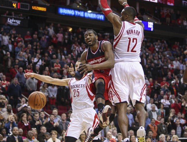 Feb 12, 2014; Houston, TX, USA; Washington Wizards point guard John Wall (2) loses control of the ball during the fourth quarter against the Houston Rockets at Toyota Center. The Rockets defeated the Wizards 113-112. Mandatory Credit: Troy Taormina-USA TODAY Sports