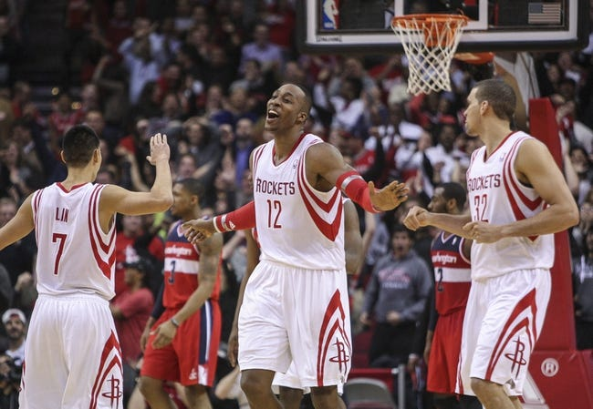 Feb 12, 2014; Houston, TX, USA; Houston Rockets center Dwight Howard (12) reacts after a play during the fourth quarter against the Washington Wizards at Toyota Center. The Rockets defeated the Wizards 113-112. Mandatory Credit: Troy Taormina-USA TODAY Sports