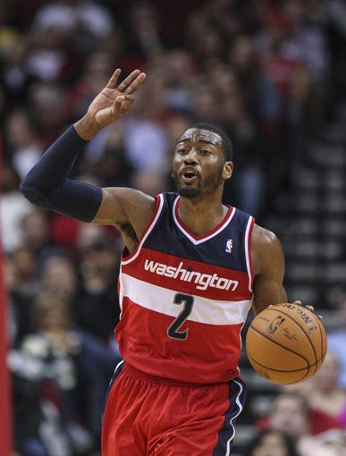 Feb 12, 2014; Houston, TX, USA; Washington Wizards point guard John Wall (2) brings the ball up the court during the third quarter against the Houston Rocketsat Toyota Center. The Rockets defeated the Wizards 113-112. Mandatory Credit: Troy Taormina-USA TODAY Sports