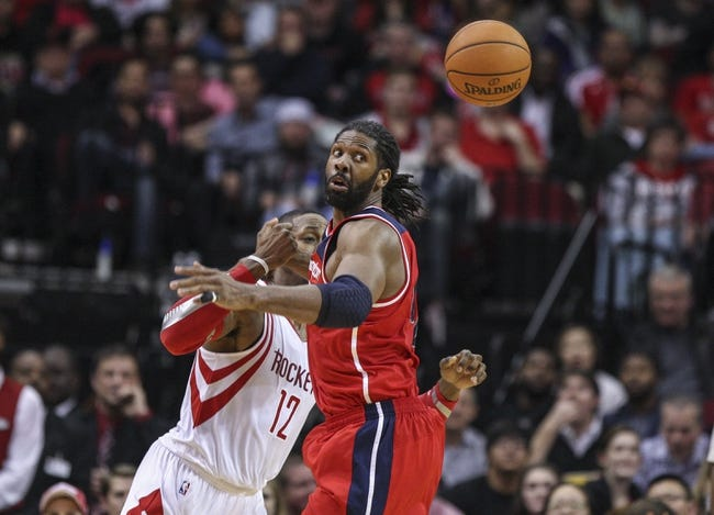 Feb 12, 2014; Houston, TX, USA; Washington Wizards power forward Nene Hilario (42) attempts to get a loose ball during the fourth quarter against the Houston Rockets at Toyota Center. Mandatory Credit: Troy Taormina-USA TODAY Sports