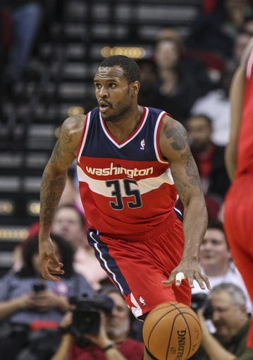 Feb 12, 2014; Houston, TX, USA; Washington Wizards power forward Trevor Booker (35) brings the ball up the court during the fourth quarter against the Houston Rockets at Toyota Center. The Rockets defeated the Wizards 113-112. Mandatory Credit: Troy Taormina-USA TODAY Sports