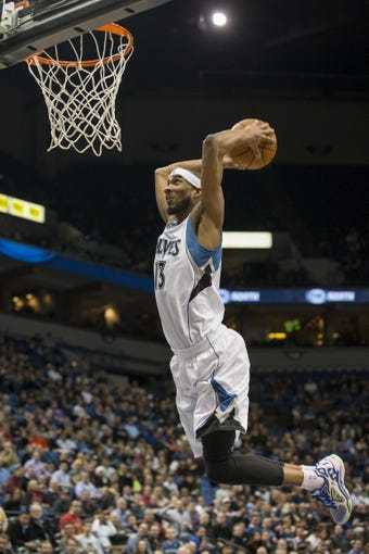 Feb 12, 2014; Minneapolis, MN, USA; Minnesota Timberwolves small forward Corey Brewer (13) dunks the ball in the second half against the Denver Nuggets at Target Center. The Timberwolves won 117-90. Mandatory Credit: Jesse Johnson-USA TODAY Sports