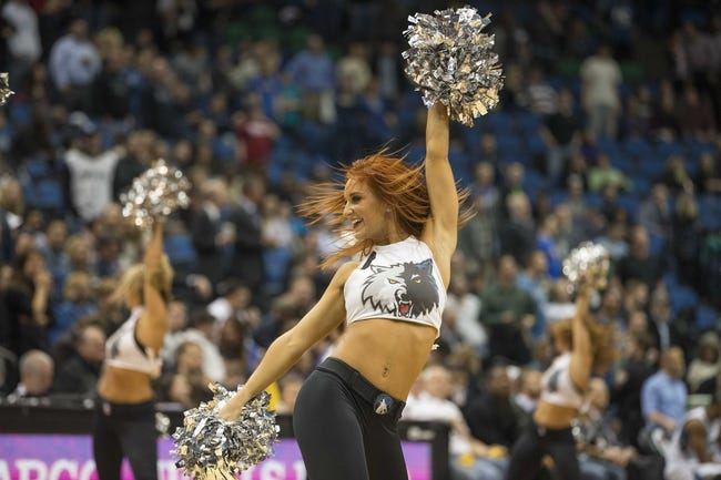Feb 12, 2014; Minneapolis, MN, USA; Minnesota Timberwolves dancer performs during the second half against the Denver Nuggets at Target Center. The Timberwolves won 117-90. Mandatory Credit: Jesse Johnson-USA TODAY Sports