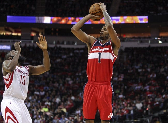 Feb 12, 2014; Houston, TX, USA; Washington Wizards small forward Trevor Ariza (1) shoots during the third quarter against the Houston Rockets at Toyota Center. The Rockets defeated the Wizards 113-112. Mandatory Credit: Troy Taormina-USA TODAY Sports
