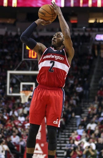 Feb 12, 2014; Houston, TX, USA; Washington Wizards point guard John Wall (2) shoots during the fourth quarter against the Houston Rockets at Toyota Center. The Rockets defeated the Wizards 113-112. Mandatory Credit: Troy Taormina-USA TODAY Sports