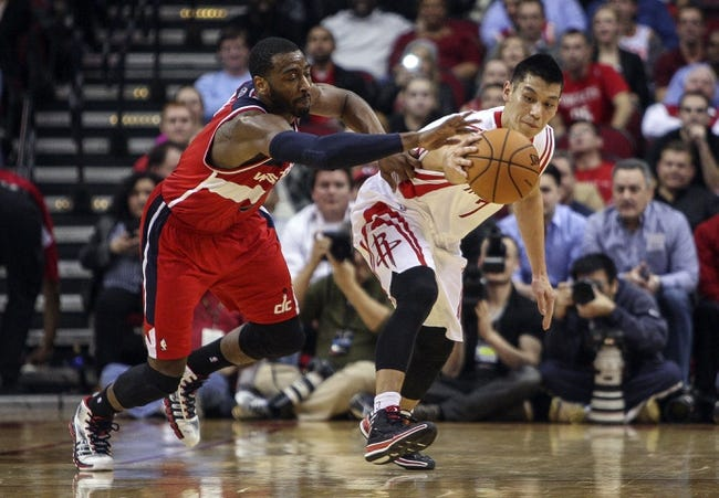 Feb 12, 2014; Houston, TX, USA; Washington Wizards point guard John Wall (2) attempts to steal the ball from Houston Rockets point guard Jeremy Lin (7) during the third quarter at Toyota Center. The Rockets defeated the Wizards 113-112. Mandatory Credit: Troy Taormina-USA TODAY Sports