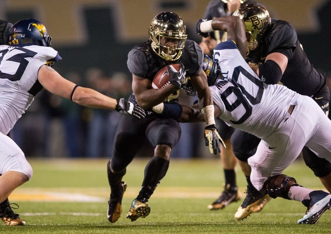 Oct 5, 2013; Waco, TX, USA; Baylor Bears running back Lache Seastrunk (25) during the game against the West Virginia Mountaineers at Floyd Casey Stadium. The Bears defeated the Mountaineers 73-42. Mandatory Credit: Jerome Miron-USA TODAY Sports