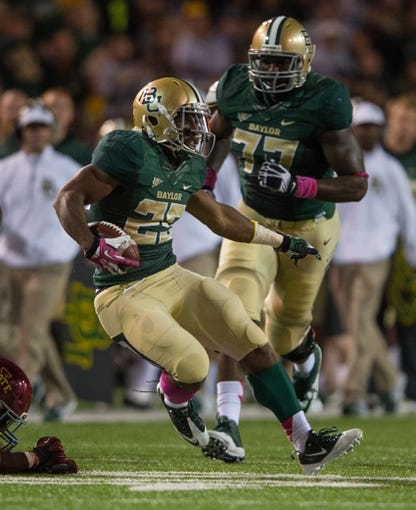 Oct 19, 2013; Waco, TX, USA; Baylor Bears running back Lache Seastrunk (25) during the game against the Iowa State Cyclones at Floyd Casey Stadium. The Bears defeated the Cyclones 71-7. Mandatory Credit: Jerome Miron-USA TODAY Sports
