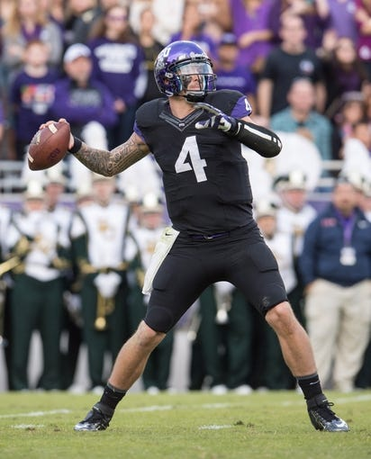 Nov 30, 2013; Fort Worth, TX, USA; TCU Horned Frogs quarterback Casey Pachall (4) during the game against the Baylor Bears at Amon G. Carter Stadium. The Bears defeated the Horned Frogs 41-38. Mandatory Credit: Jerome Miron-USA TODAY Sports
