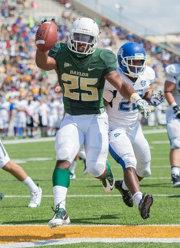 Sep 7, 2013; Waco, TX, USA; Baylor Bears running back Lache Seastrunk (25) during the game against the Buffalo Bulls at Floyd Casey Stadium. The Bears defeated the Bulls 70-13. Mandatory Credit: Jerome Miron-USA TODAY Sports