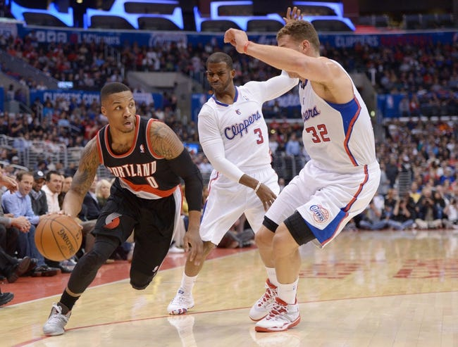 Feb 12, 2014; Los Angeles, CA, USA; Portland Trail Blazers guard Damian Lillard (0) is defended by Los Angeles Clippers guard Chris Paul (3) and forward Blake Griffin (32) at Staples Center. Mandatory Credit: Kirby Lee-USA TODAY Sports