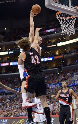 Feb 12, 2014; Los Angeles, CA, USA; Los Angeles Clippers forward Blake Griffin (32) is fouled by Portland Trail Blazers center Robin Lopez (42) at Staples Center. The Clippers defeated the Trail Blazers 122-117. Mandatory Credit: Kirby Lee-USA TODAY Sports
