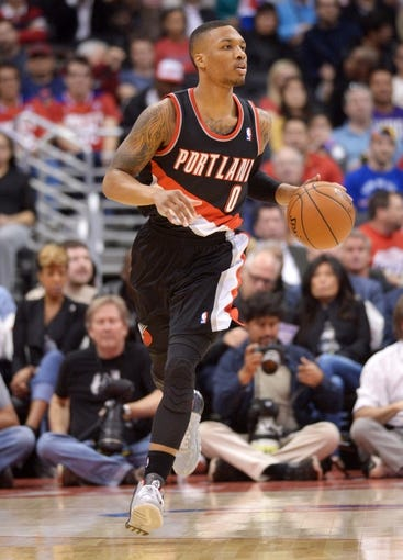 Feb 12, 2014; Los Angeles, CA, USA; Portland Trail Blazers guard Damian Lillard (0) dribbles the ball against the Los Angeles Clippers at Staples Center. Mandatory Credit: Kirby Lee-USA TODAY Sports
