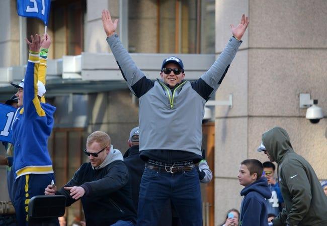Feb 5, 2014; Seattle, WA, USA; Seattle Seahawks punter Steven Hauschka (center) and punter Jon Ryan (left) at Super Bowl XLVIII victory parade on 4th Avenue. Mandatory Credit: Kirby Lee-USA TODAY Sports