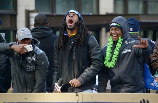 Feb 5, 2014; Seattle, WA, USA; Seattle Seahawks cornerback Richard Sherman (center) at Super Bowl XLVIII victory parade on 4th Avenue. Mandatory Credit: Kirby Lee-USA TODAY Sports