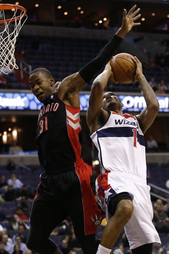 Feb 18, 2014; Washington, DC, USA; Washington Wizards small forward Trevor Ariza (1) shoots the ball as Toronto Raptors small forward Terrence Ross (31) defends in the first quarter at Verizon Center. Mandatory Credit: Geoff Burke-USA TODAY Sports