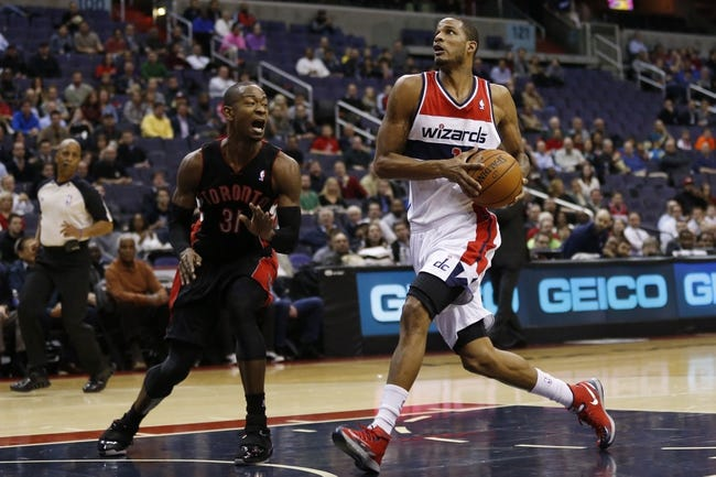 Feb 18, 2014; Washington, DC, USA; Washington Wizards small forward Trevor Ariza (1) prepares to shoot the ball in front of Toronto Raptors small forward Terrence Ross (31) in the first quarter at Verizon Center. Mandatory Credit: Geoff Burke-USA TODAY Sports