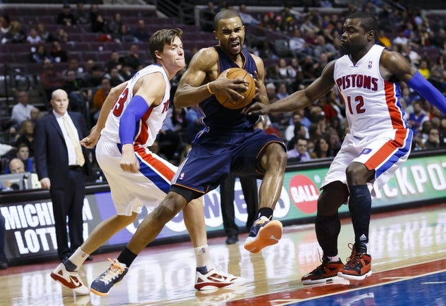 Feb 18, 2014; Auburn Hills, MI, USA; Charlotte Bobcats point guard Ramon Sessions (7) moves the ball on Detroit Pistons power forward Jonas Jerebko (33) and point guard Will Bynum (12) in the second quarter at The Palace of Auburn Hills. Mandatory Credit: Rick Osentoski-USA TODAY Sports