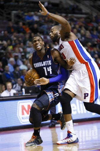 Feb 18, 2014; Auburn Hills, MI, USA; Charlotte Bobcats small forward Michael Kidd-Gilchrist (14) is fouled by Detroit Pistons power forward Greg Monroe (10) in the second quarter at The Palace of Auburn Hills. Mandatory Credit: Rick Osentoski-USA TODAY Sports