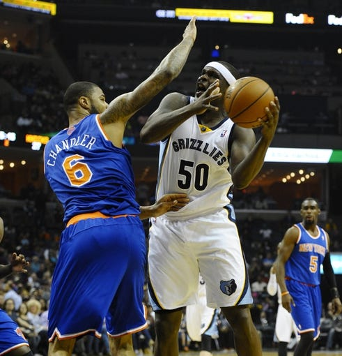 Feb 18, 2014; Memphis, TN, USA; Memphis Grizzlies power forward Zach Randolph (50) handles the ball against New York Knicks center Tyson Chandler (6) during the second quarter at FedExForum. Mandatory Credit: Justin Ford-USA TODAY Sports