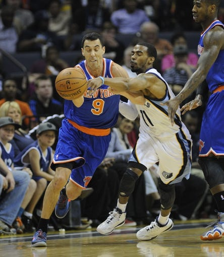 Feb 18, 2014; Memphis, TN, USA; New York Knicks point guard Pablo Prigioni (9) and Memphis Grizzlies point guard Mike Conley (11) fight for the ball during the first quarter at FedExForum. Mandatory Credit: Justin Ford-USA TODAY Sports
