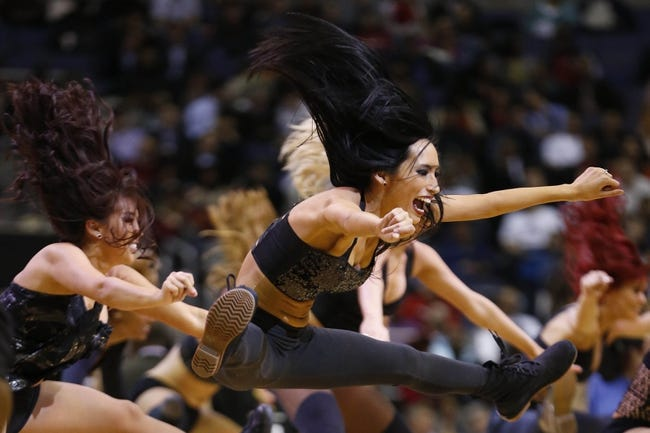 Feb 18, 2014; Washington, DC, USA; Washington Wizards girls dance on the court during a stoppage in play against the Toronto Raptors at Verizon Center. The Raptors won 103-93. Mandatory Credit: Geoff Burke-USA TODAY Sports