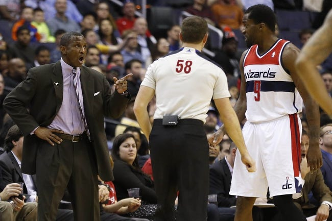 Feb 18, 2014; Washington, DC, USA; Toronto Raptors head coach Dwane Casey yells at referee Josh Tiven (58) against the Washington Wizards in the fourth quarter at Verizon Center. The Raptors won 103-93. Mandatory Credit: Geoff Burke-USA TODAY Sports