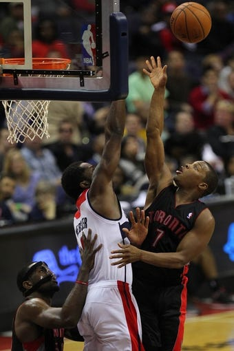 Feb 18, 2014; Washington, DC, USA; Toronto Raptors point guard Kyle Lowry (7) shoots the ball over Washington Wizards small forward Martell Webster (9) in the fourth quarter at Verizon Center. The Raptors won 103-93. Mandatory Credit: Geoff Burke-USA TODAY Sports