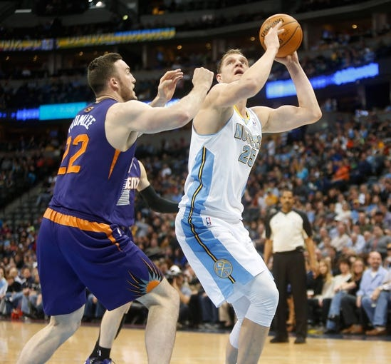 Feb 18, 2014; Denver, CO, USA; Denver Nuggets center Timofey Mozgov (25) shoots the ball during the first half against the Phoenix Suns at Pepsi Center. Mandatory Credit: Chris Humphreys-USA TODAY Sports