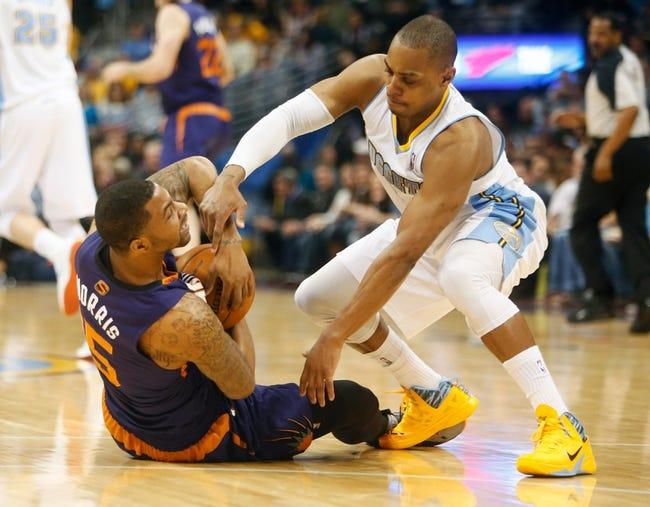 Feb 18, 2014; Denver, CO, USA; Denver Nuggets guard Randy Foye (4) battles with Phoenix Suns forward Marcus Morris (15) during the first half at Pepsi Center. Mandatory Credit: Chris Humphreys-USA TODAY Sports