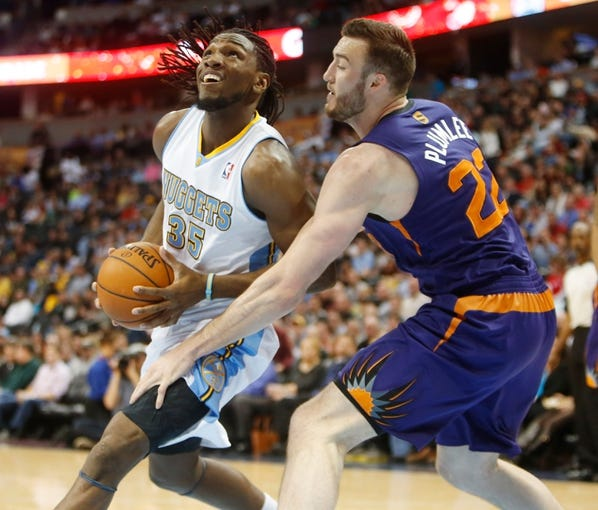 Feb 18, 2014; Denver, CO, USA; Denver Nuggets forward Kenneth Faried (35) drives to the basket past Phoenix Suns center Miles Plumlee (22) during the first half at Pepsi Center. Mandatory Credit: Chris Humphreys-USA TODAY Sports