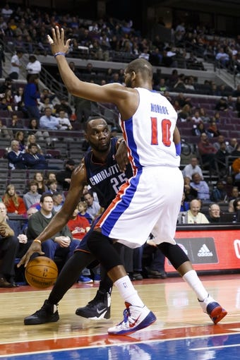 Feb 18, 2014; Auburn Hills, MI, USA; Charlotte Bobcats center Al Jefferson (25) is defended by Detroit Pistons power forward Greg Monroe (10) in the first half at The Palace of Auburn Hills. Charlotte won 108-96. Mandatory Credit: Rick Osentoski-USA TODAY Sports