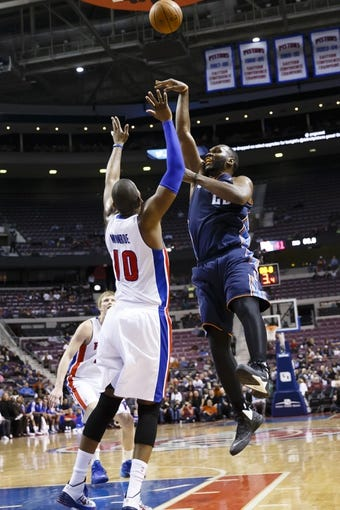 Feb 18, 2014; Auburn Hills, MI, USA; Charlotte Bobcats center Al Jefferson (25) shoots on Detroit Pistons power forward Greg Monroe (10) in the first half at The Palace of Auburn Hills. Charlotte won 108-96. Mandatory Credit: Rick Osentoski-USA TODAY Sports