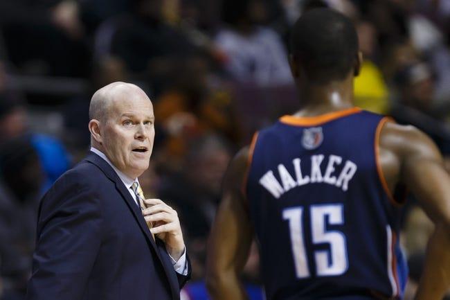 Feb 18, 2014; Auburn Hills, MI, USA; Charlotte Bobcats head coach Steve Clifford talks to point guard Kemba Walker (15) in the fourth quarter against the Detroit Pistons at The Palace of Auburn Hills. Charlotte won 108-96. Mandatory Credit: Rick Osentoski-USA TODAY Sports