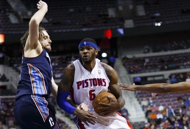 Feb 18, 2014; Auburn Hills, MI, USA; Detroit Pistons small forward Josh Smith (6) moves the ball defended by Charlotte Bobcats power forward Josh McRoberts (11) in the fourth quarter at The Palace of Auburn Hills. Charlotte won 108-96. Mandatory Credit: Rick Osentoski-USA TODAY Sports