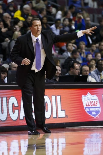 Feb 18, 2014; Auburn Hills, MI, USA; Detroit Pistons head coach John Loyer reacts in the third quarter against the Charlotte Bobcats at The Palace of Auburn Hills. Charlotte won 108-96. Mandatory Credit: Rick Osentoski-USA TODAY Sports