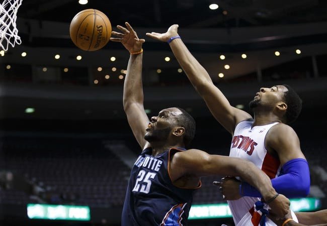 Feb 18, 2014; Auburn Hills, MI, USA; Charlotte Bobcats center Al Jefferson (25) and Detroit Pistons center Andre Drummond (0) goes for the rebound in the fourth quarter at The Palace of Auburn Hills. Charlotte won 108-96. Mandatory Credit: Rick Osentoski-USA TODAY Sports
