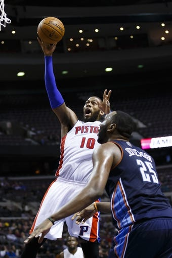 Feb 18, 2014; Auburn Hills, MI, USA; Detroit Pistons power forward Greg Monroe (10) shoots on Charlotte Bobcats center Al Jefferson (25) in the fourth quarter at The Palace of Auburn Hills. Charlotte won 108-96. Mandatory Credit: Rick Osentoski-USA TODAY Sports
