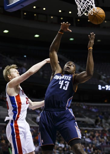 Feb 18, 2014; Auburn Hills, MI, USA; Detroit Pistons small forward Kyle Singler (25) and Charlotte Bobcats power forward Anthony Tolliver (43) goes for the rebound in the fourth quarter at The Palace of Auburn Hills. Charlotte won 108-96. Mandatory Credit: Rick Osentoski-USA TODAY Sports