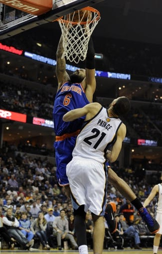 Feb 18, 2014; Memphis, TN, USA; New York Knicks center Tyson Chandler (6) dunks the ball over Memphis Grizzlies small forward Tayshaun Prince (21) during the game at FedExForum. Memphis Grizzlies beat New York Knicks 98 - 93. Mandatory Credit: Justin Ford-USA TODAY Sports