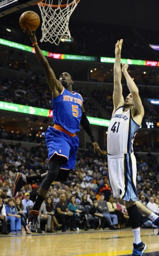 Feb 18, 2014; Memphis, TN, USA; New York Knicks shooting guard Tim Hardaway Jr. (5) lays the ball up over Memphis Grizzlies center Kosta Koufos (41) during the game at FedExForum. Memphis Grizzlies beat New York Knicks 98 - 93. Mandatory Credit: Justin Ford-USA TODAY Sports